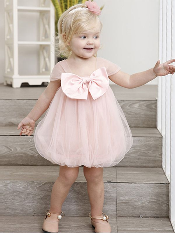 41849069b0b66 ... Kiskissing Cute Little Girls Sundress Cap Sleeves Bowknot Tulle Dress  For Toddler Girls the model show ...