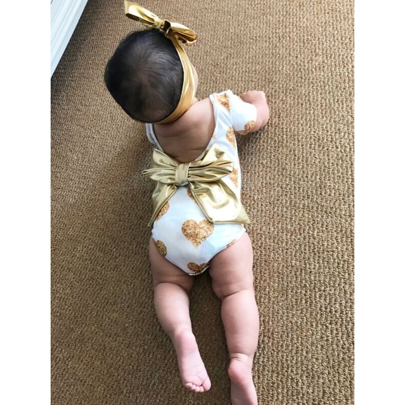 Kiskissing Hearts Pattern Printed Golden Bow Romper for Babies model show trendy kids wholesale clothing