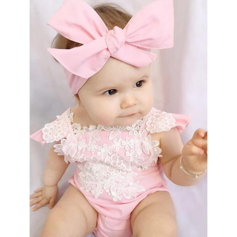 Kiskissing Cute pink Lace Cap-sleeve Straps Pink Romper for Baby Girls the model show wholesale baby clothes