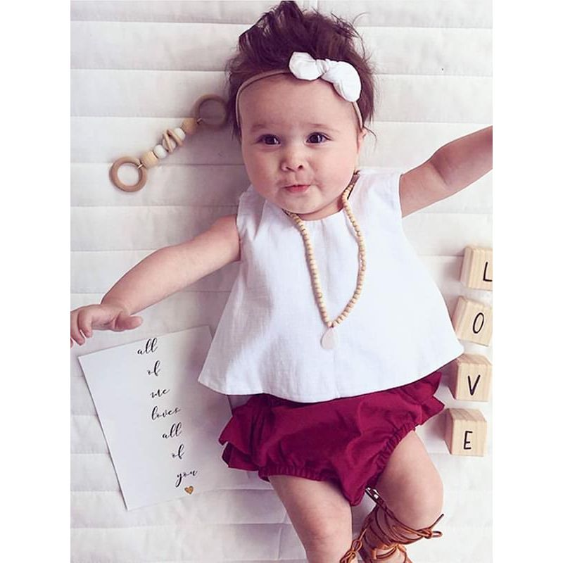 Kiskissing 3-piece Top Flounced Shorts Headband Set for Baby Toddler Girls the model show wholesale kids clothing set