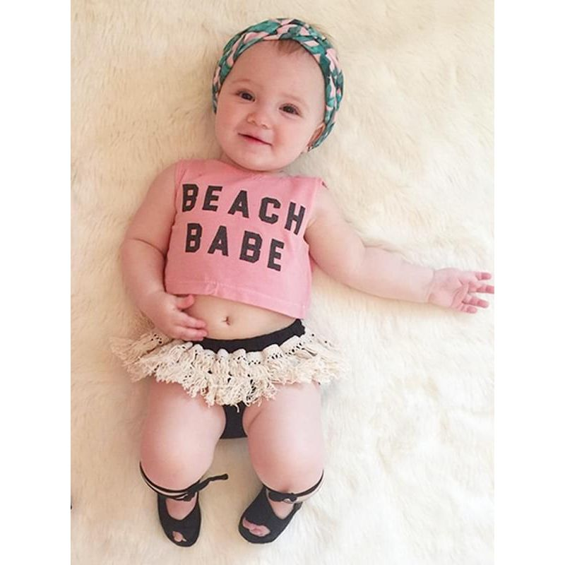 Kiskissing 2-piece Letters Printed Sleeveless Top Fringed Shorts Set for Baby Toddler Girls the model show wholesale kids clothing
