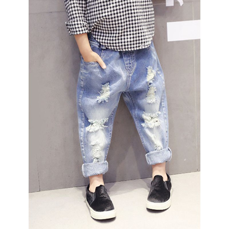 Kiskissing Light-blue Ripped Jeans Denim Pants Trousers for Toddlers Girls Boys the model show wholesale children's boutique clothing